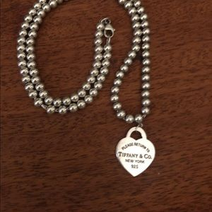 Return to Tiffany beaded necklace with heat charm.